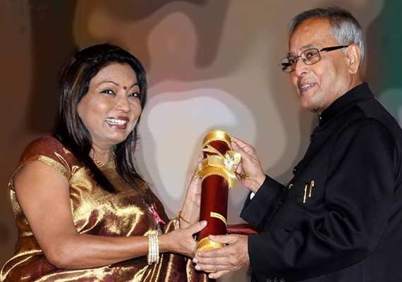 Kalpana Saroj receiving Padma Shri award from the then President of India